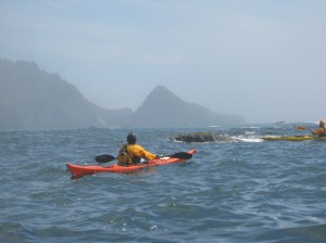 Sea kayaker paddling open water along the Lost Coast