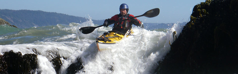 Kayaker running a pour-over